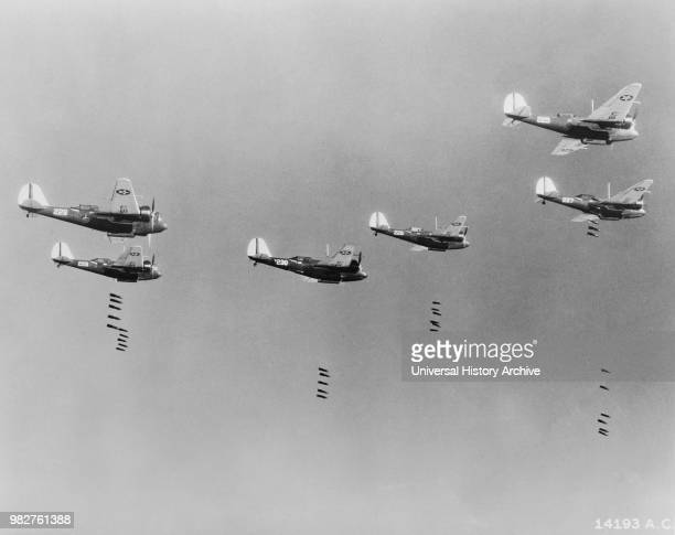 Pound Bombs falling from Formation of B-10 Bombers in Bombing Practice by 19th Bombardment Group, U.S. Army Air Corps, Office of War Information,...