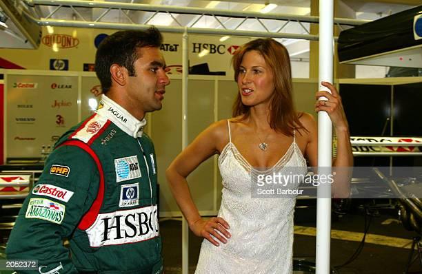 Model Julienne Davis wearing Steinmetz's 51carat internally flawless heartshaped diamond necklace chats to Jaguar racing driver Antonio Pizzonia at...