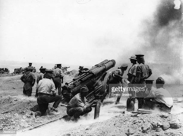 A 60pounder heavy field gun in action on a cliff top at Helles Bay Gallipoli Turkey
