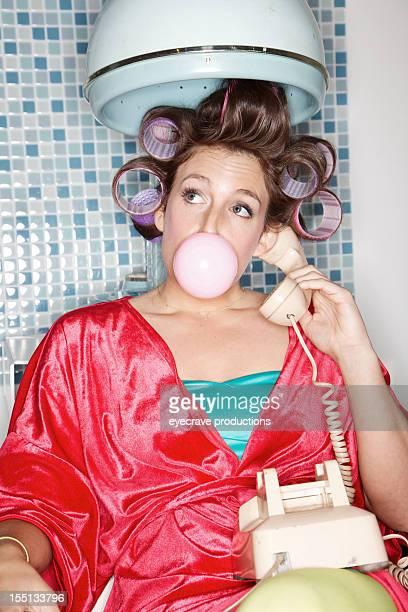 60s vintage retro female blowing bubble
