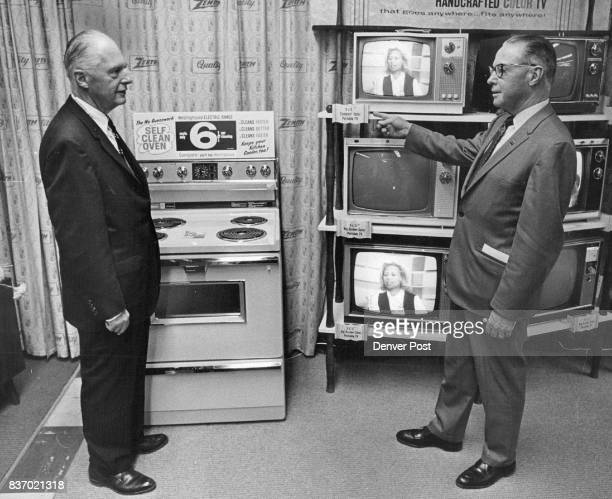 SEP 12 1969 SEP 15 1969 60th Anniversary for McCollum Law C W Kreider left vice president j and W S Law president of McCollum Law Corp discuss their...