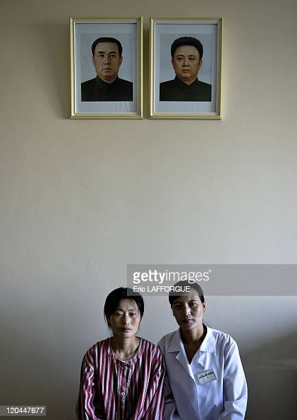 60th Anniversary of North Korea in Pyongyang North Korea on September 17 2008 Docotor and patient at maternity hospital under the portraits of the...