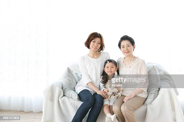 60th generation grand mother and 20th generation mother and 5-9 year old daughter who sit on a sofa