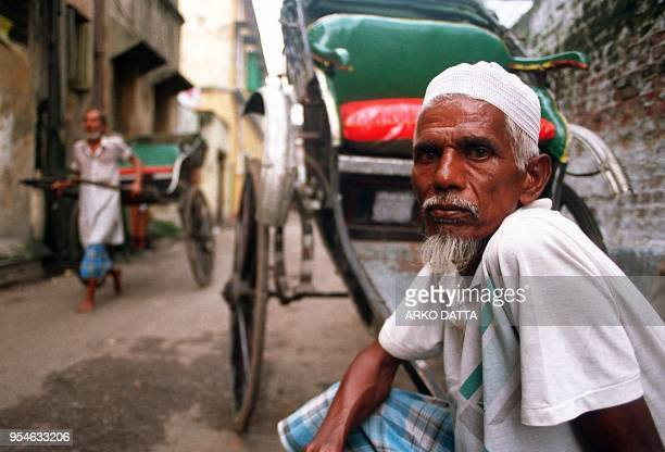 60yearold Sheikh Akbar a rickshaw puller for the past 35 years waits for customers 28 July on a street in Calcutta India's 50 years of independence...