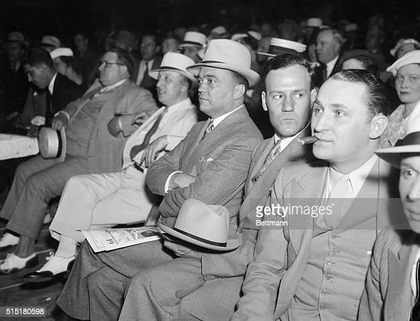 Washington, D.C.- J. Edgar Hoover , head of the Department of Justice, is pictured here attending the Frankie Klick-Tony Canzoneri fight. Hoover,...