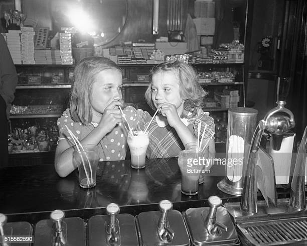 Leona Wasyn left and Dorothy Wagner shown enjoying an ice cream soda believe that honesty is the best policy While playing yesterday they found a tin...