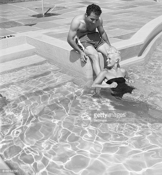 6/10/1950Lake Kiamesha NY Jake La Motta cools his feet with his wife Vickie during training at Lake Kiamesha The world middleweight king will meet...