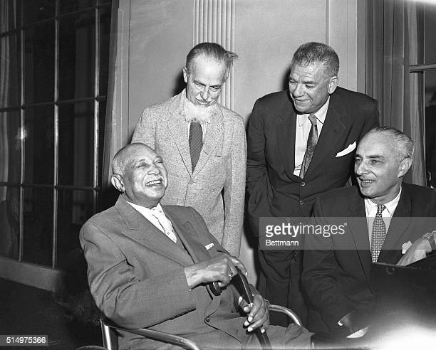 6/10/1957New York New York Getting together for a talk prior to a meeting of the SOngwriters' Protective Association here are composer WC Handy...