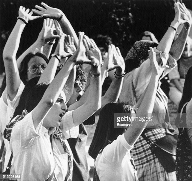 6/10/1977Rome Italy Women demonstrators raise their hands in the feminist salute during a protest march against the Senate's rejection of an abortion...