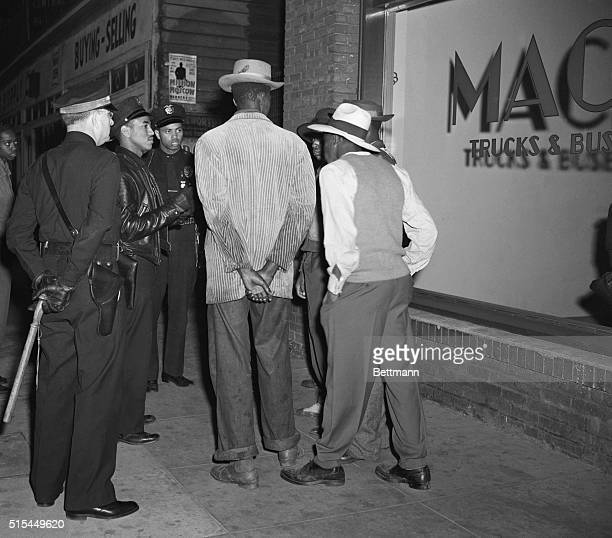 6/11/1943Los Angeles CA Los Angeles policemen examine draft credentials as they continue the roundup of zootsuit suspects in the aftermath of the...
