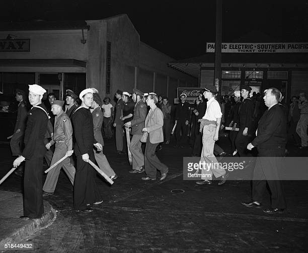 6/11/1943Watts California Armed with clubs pipes and bottles this selfappointed posse of uniformed men was all set to settle the Zoot Suit War when...