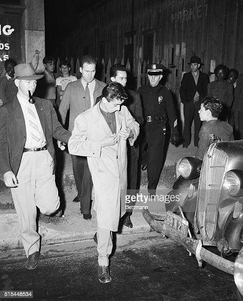 6/11/1943Watts California Police officers take this zoot suit clad youngster into custody after the sixth day of undeclared war on the reat pleat in...