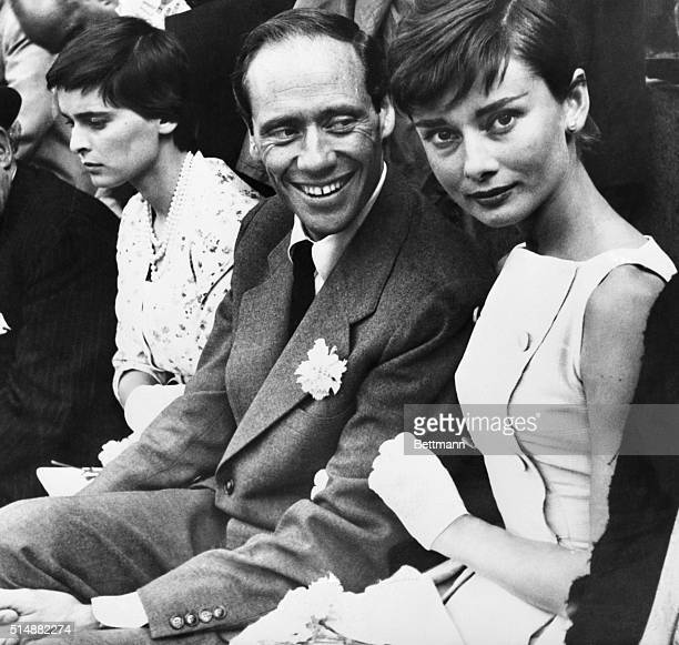 6/11/1955Madrid Spain Mel Ferrer and his actress wife Audrey Hepburn are shown as they attended thier first bullfight in Madrid At left is Lucia Bose...