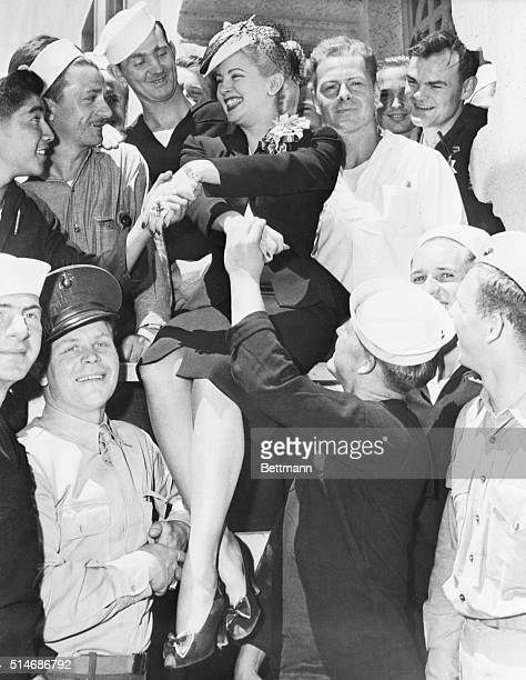 6/11/42San Francisco California Blonde screen star and wellknown Sweater Girl Lana Turner as she became the victim of a near riot June 9th when she...