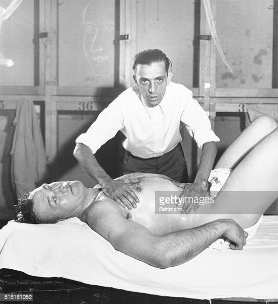 6/1/1933Orangeburg NY Jack Sharkey world heavyweight champ gets a rubdown from his trainer at Gus Wilson's training camp here as he gets into shape...