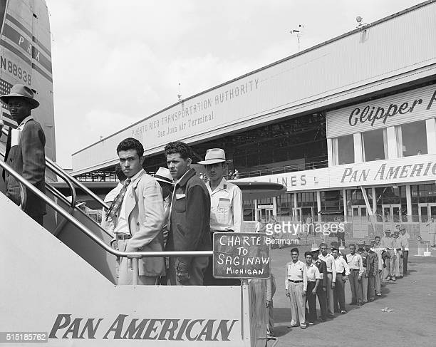 San Juan, Puerto Rico- At San Juan's Isla Grande Airport, migratory farm workers are shown boarding one of the special planes which took them to the...