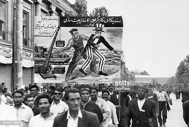 6/1/1951TeheranIran Above is one of the AntiAmerican posters carried in the big parade of 100000 workers and peasants staged last Tuesday in Teheran...