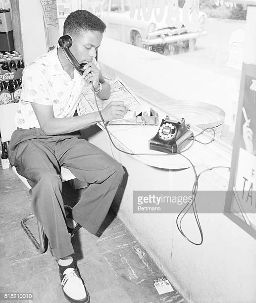 6/1/1956Tallahassee FL Florida AM student Eugene Lincoln acting as the dispatcher for a car pool being operated here June 1st gives instructions over...
