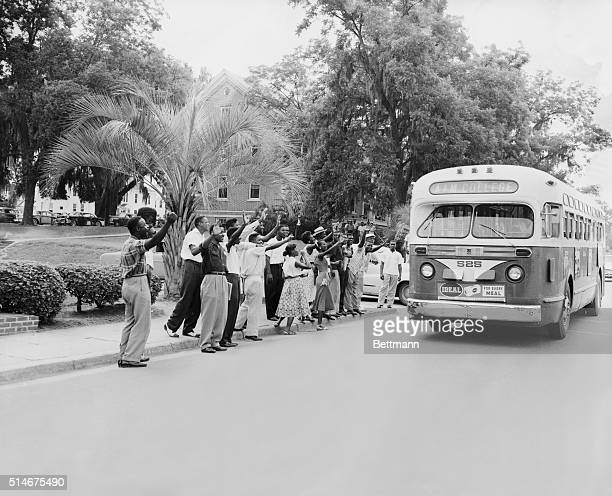 Tallahassee, FL: Negro students at Florida A&M College jeer at the driver of a city bus as he drives his empty vehicle across the school campus here,...