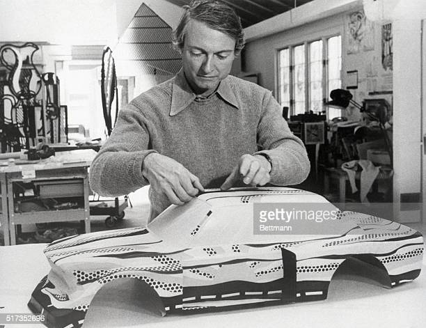 6/1/1977Southampton NY Artist Roy Lichtenstein paints a model of the racing version of BMW's street model 320i in his Southampton studio recently His...