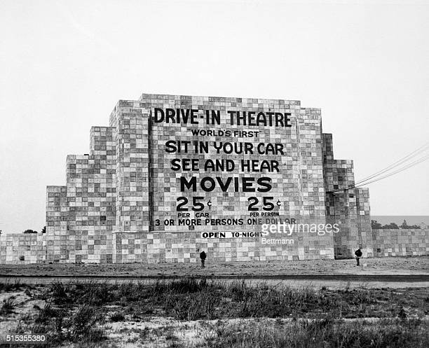 6/12/1933Camden NJ Back view of a huge drivein movie screen a wall with advertisement and admission prices