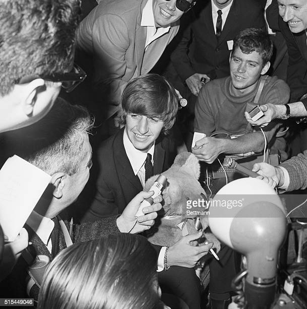 6/12/1964San Francisco California Ringo Starr of the Beatles sits holding a stuffed bear as he's surrounded by newsmen upon his arrival at San...