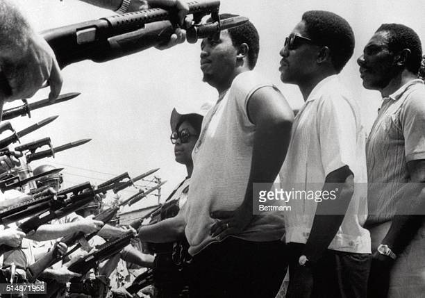 6/12/1968Prichard AL Leaders of a march of about 255 persons stare at police officers who stopped the predominately Negro group from marching on city...