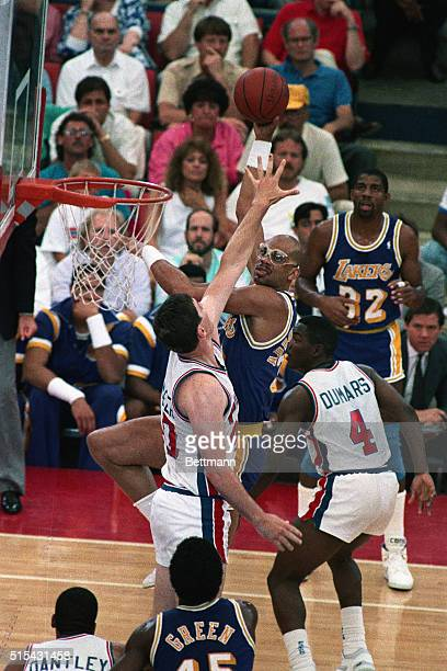 6/12/1988Pontiac MI Los Angeles Laker's Kareem AbdulJabbar hooks the ball over Detroit Piston Bill Laimbeer in the 2nd quarter of their game