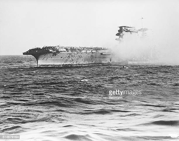 6/12/42Washington DC Men swarm over the side of the aircraft carrier USS Lexington on the captain's order to abandon ship after it was hit by Japs in...