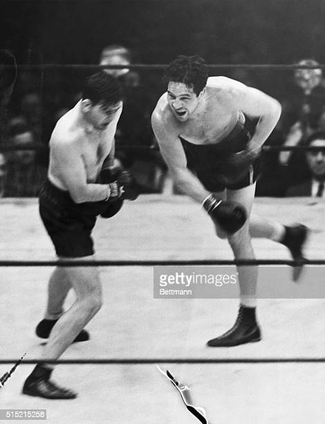 6/13/1935Jimmy Braddock wins the title from Max Baer who is shown here missing with his famed right