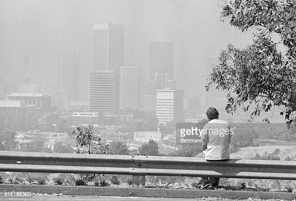 6/13/1979Los Angeles CA A lone spectator views a smogcovered downtown Los Angeles 6/13 Sunscorched southern California still broiling in sweltering...
