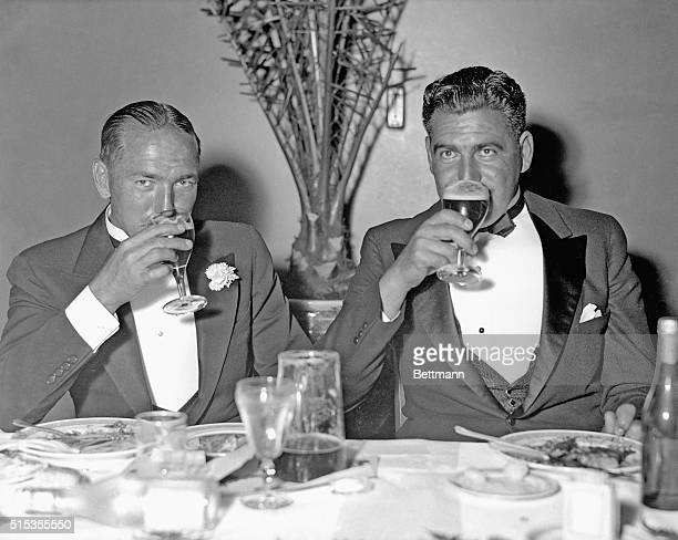 6/14/1933New York NY Leo Diegel and Olin Dutra quaff a glass of beer as they attend the farewell dinner held for the US Ryder Cup team atteh...