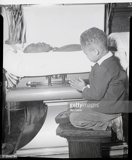 Little James Short kneels in prayer as he pays his last respects to the late Jack Johnson former World's Heavyweight Champion who was killed in an...