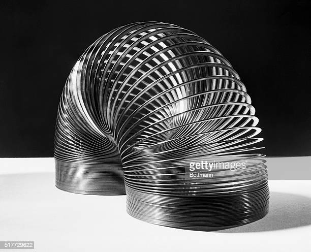 6/14/1946Photo shows the 'Slinky' a toy invented by Civil Engineer Richard R James of Philadelphia after he watched a steel spring roll off a war...