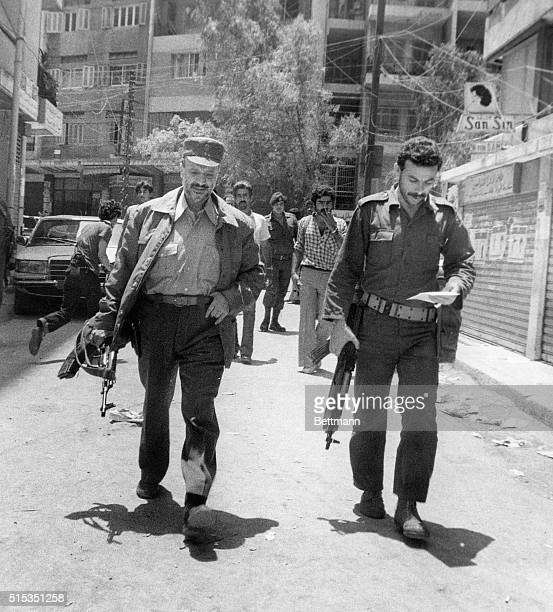 6/14/1982Beirut Lebanon A grim Yasser Arafat leader of the Palestine Liberation Orginization walks with an aide in the Arab University area in Beirut...