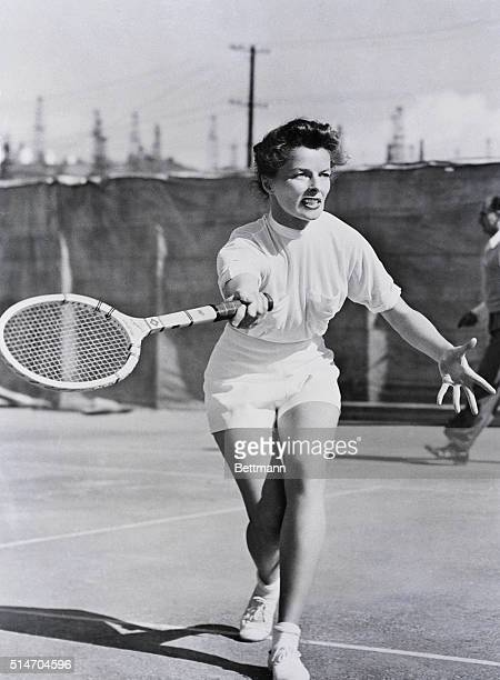 6/14/52Hollywood California Screen star Katharine Hepburn gets out in tennis togs for a few volleys and her good looks on the court to be competition...