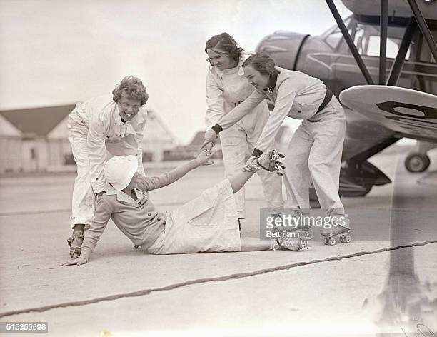 6/15/1933Roosevelt Field LI NY The other three skating contestants aid Mrs Betty H Gillies to her feet after she had crahsed during practice roller...