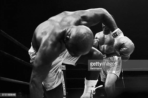 Uniondale, New YorkUnder a barrage by George Foreman, Joe Frazier heads for the canvas in the fifth round.