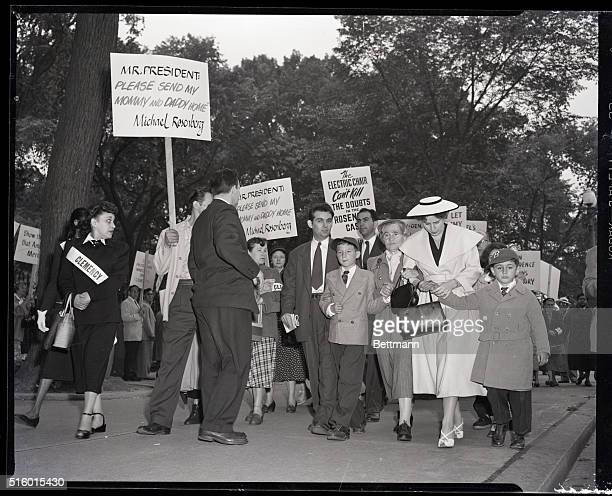 The two young sons of convicted atom spies Julius and Ethel Rosenberg take part in a giant demonstration in front of the White House asking...