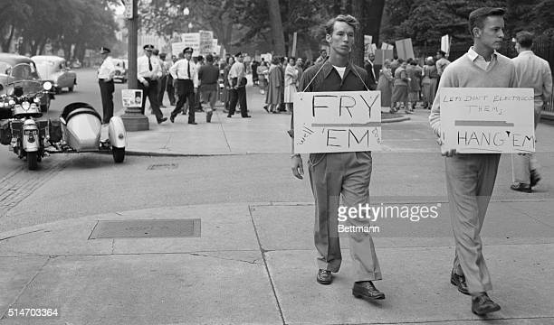 While hundreds of placardwaving demonstrators parade before the White House asking for presidential clemency for atom spies Julius and Ethel...