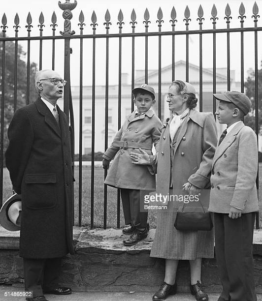 With their grandmother the two young sons of convicted atom spies Julius and Ethel Rosenberg watch as Rabbi Abraham Kronback of Cincinnati Ohio...