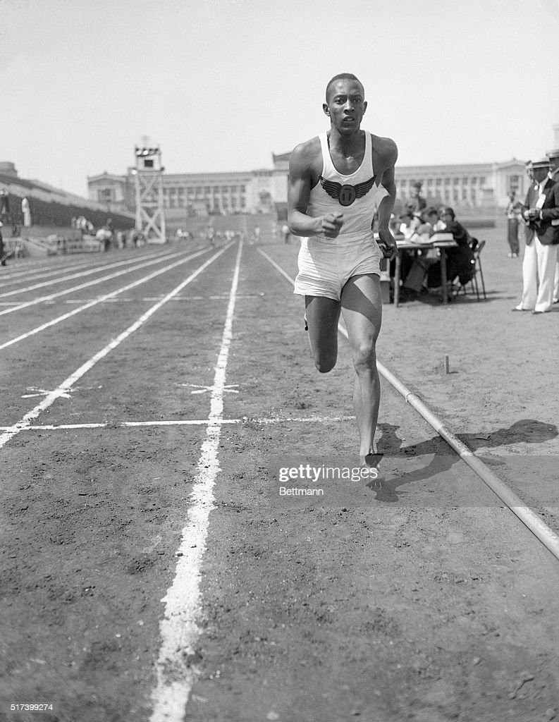 Jesse Owens Running In Track Meet : News Photo