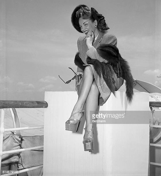 6/17/1948New York NY Sporting skyscraper platform shoes Carmen Miranda poses prettily on her return from Europe aboard the SS America today She was...