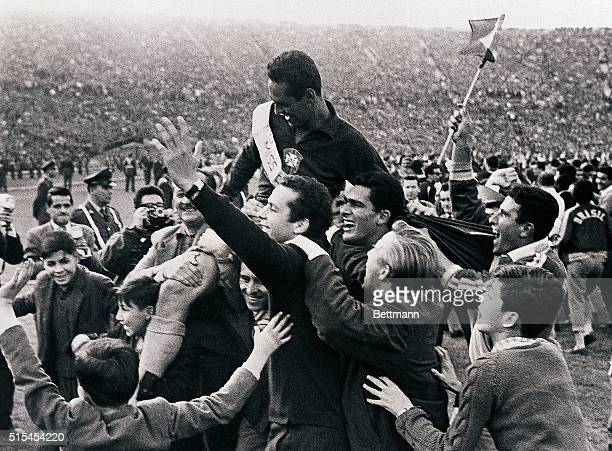 Santiago, Chile-: Jubilant fans hoist Brazilian goalie Gilmar on their shoulders at National Stadium after Brazil beat Czechoslovakia, 3-1, to retain...