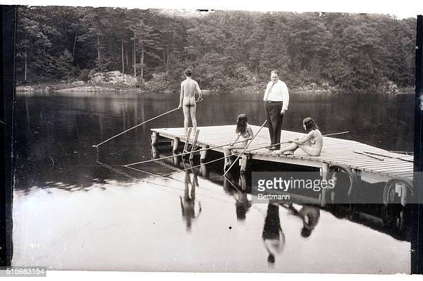 6/18/1932New Paltz NY Men and women fish off of a dock at the nudist colony at New Paltz