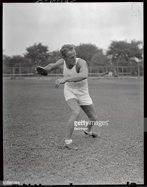 6/18/1932Olympic Meet at Harvard Stadium John F Anderson NYAC discus Shown here throwing the discus