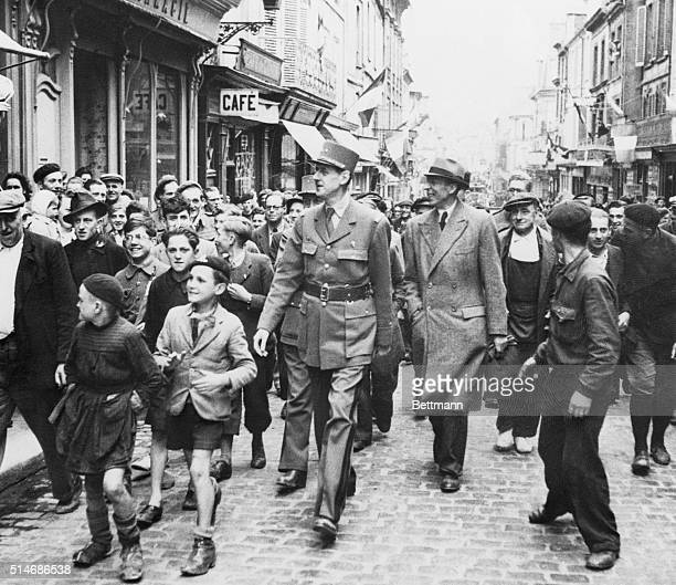 6/18/1944Bayeux France With small boys leading the way Gen Charles de Gaulle walks through the streets of Bayeux surrounded on all sides by...