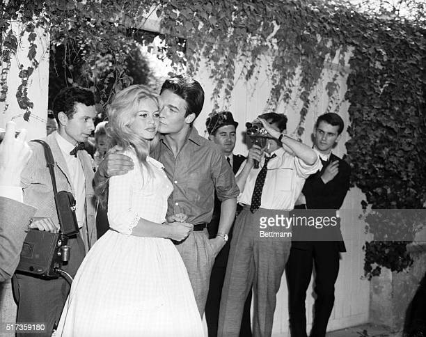 6/18/1959Louveciennes France French movie actress Brigitte Bardot gets a kiss from her new husband actor Jacques Charrier in the garden of her...