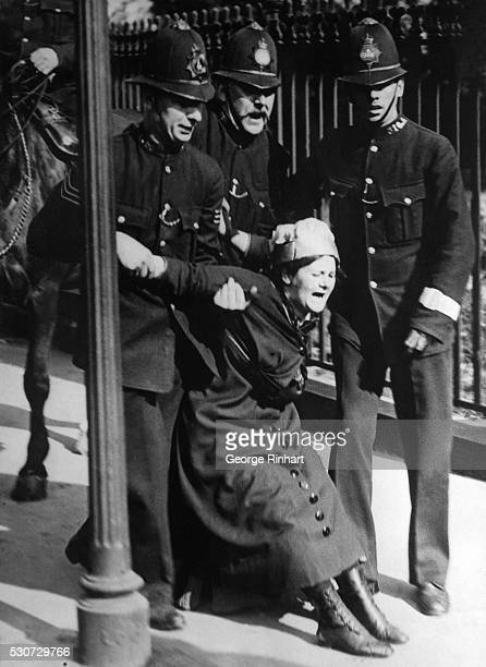 6/1914London England Three bobbies arrest a suffragette outside Buckingham Palace Photograph London June 1914