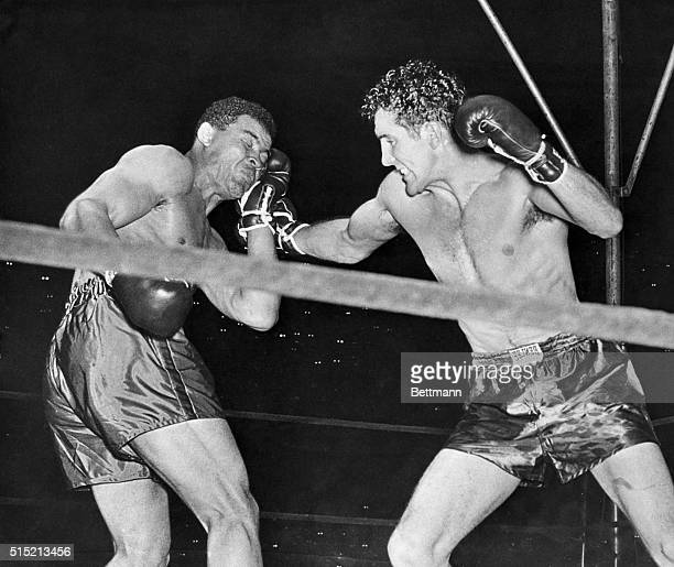 6/19/1941New York NY Joe Louis seems to be cushioning his head on his glove and waiting for challenger Billy Conn to rock him to sleep with his right...
